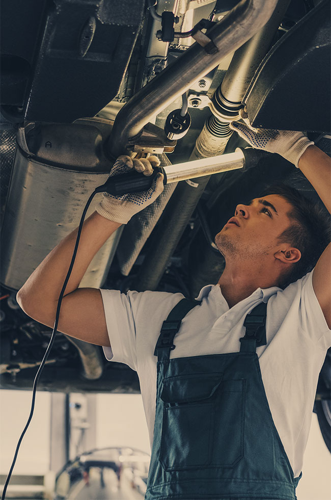 Mechanic looking under a vehicle - Servicing, Repairs, MOT's Glenrothes, Fife.